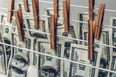 Money Laundering concept. US dollars hung out to dry Stock Images