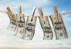 Money Laundering. Currency Clothesline Laundry Dollar Clean Clothespin Royalty Free Stock Images
