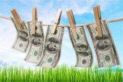 Money laundering. Currency clothesline laundry dollar clean clothespin Stock Image