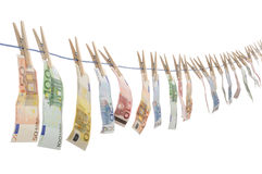 Money Laundering. Euro money banknotes hanging on the washing line Royalty Free Stock Photography