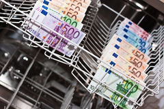 Money laundering with euronotes. Money laundering in the dishwasher Stock Photography