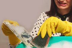Money laundering (illegal cash, dollars bill, shady money, corr. Woman launder shady money (illegal cash, dollars bill, corruption, manipulation Stock Photography