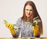 Money laundering (illegal cash, dollars bill, shady money, corruption, manipulation). Woman launder shady money (illegal cash, dollars bill, corruption royalty free stock images