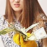 Money laundering (illegal cash, dollars bill, shady money, corruption, manipulation). Woman launder shady money (illegal cash, dollars bill, corruption stock image