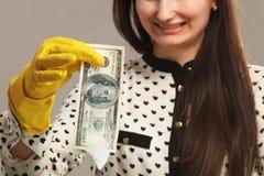 Money laundering (illegal cash, dollars bill, shady money, corru. Woman launder shady money (illegal cash, dollars bill, corruption, manipulation Royalty Free Stock Photos