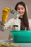 Money laundering (illegal cash, dollars bill, shady money, corru. Woman launder shady money (illegal cash, dollars bill, corruption, manipulation Royalty Free Stock Image