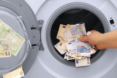 Money laundering illegal cash euros and pounds. Hand money laundering problem illegal cash euros and pounds Royalty Free Stock Photography