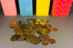 Money laundering. Stack of colorful sponges in a row and  coins Stock Photo