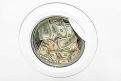 Money laundering in washing machine Stock Images