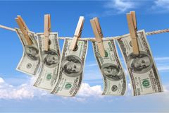 Dollars on the line with clothes pins. Money laundering white money wealth business success power Royalty Free Stock Photos