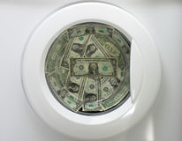 Money Laundry. A washing machine with dollars inside Royalty Free Stock Photography