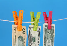 Money laundry. Three US dollar bills hanging on a washing line Stock Photo