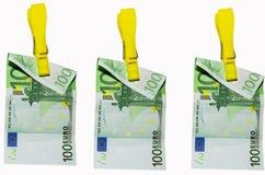 Money laundry, euro banknotes on clothespin. Euro banknotes hanging on clothespins on white background Stock Photos