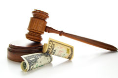 Money law. Law gavel with cash, isolated on white Stock Image