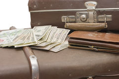 Money lays on an old suitcase Stock Photo