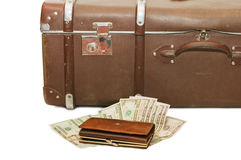 Money lays on an old suitcase Stock Photography