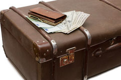 Money lays on an old suitcase Stock Images