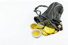 Money in leather pouch Stock Photo