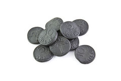Money from licorice. Licorice sweets in the form of a coins Stock Photo