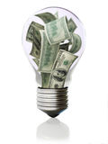 Money in light bulb concept. Hi cost of energy Stock Image