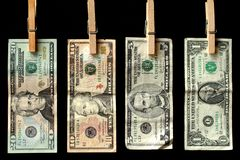 Money Line. Four American Bills, the one, the five, the ten, and the twenty,  hanging in a row Royalty Free Stock Photos
