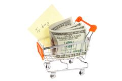 Money, list of purchases in shopping cart on white Royalty Free Stock Photography