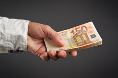 Money Loan. Bank officer loaning stack of euro banknotes money stock image
