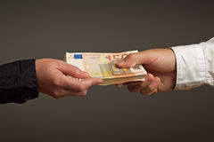 Money Loan. Bank officer loaning stack of euro banknotes money stock photography