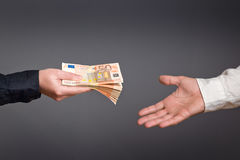 Money Loan. Bank officer loaning stack of euro banknotes money royalty free stock photo
