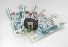 Money locked Stock Images