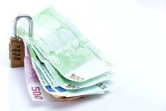 Money locked. Conceptual photo with some euros locked Royalty Free Stock Photo