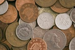 Money in loose change Royalty Free Stock Photos