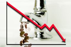 Money Loss. Money flowing out of a retro bathroom tap with a graph going down overlayed Stock Photography