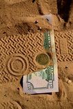 Money lost in the desert. 50 dollars 50 cents coin Stock Photos