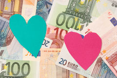Money and love Stock Photography