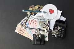 Money and love. Heart trought a magnification glass, love costs money Stock Photos
