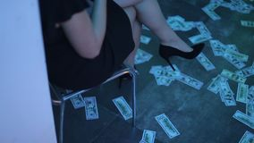 Money is lying on the floor in the club room at a party. People go for the money. stock video footage