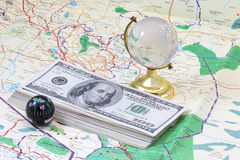 Money lying on the map Stock Photography
