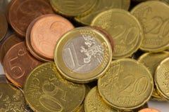 Money macro, one Euro on pile of coins Royalty Free Stock Photos