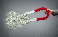Money magnet. Businessman attracting money with a horseshoe magnet concept for business success, strategy or greed