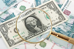 Money and magnifier Royalty Free Stock Photography