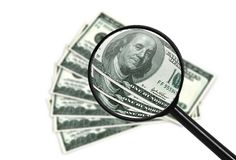Money and magnifying Royalty Free Stock Image