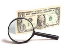 Money and magnifying glass Royalty Free Stock Photo