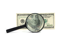 Money and magnifying glass Royalty Free Stock Photos