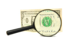 Money and magnifying glass Royalty Free Stock Photography