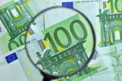 Money magnifying glass royalty free stock photos