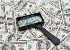 Money and magnifying glass Stock Photography