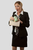 Money in the Mail. Attractive blond caucasian woman wearing a black business suit with tie holding an open envelope and taking out canadian money with a shocked royalty free stock photos
