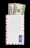 Money in the Mail. Two 100 dollar bills coming out of a ripped white envelope Royalty Free Stock Image