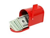 Money in the mailbox. Red metal mailbox with signal flag full of large bills of money - path included stock images